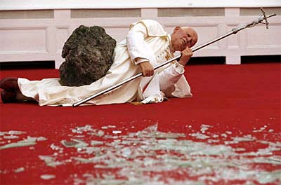 Maurizio Cattelans 1999 sculpture of Pope John Paul II after having been struck by a meteorite.