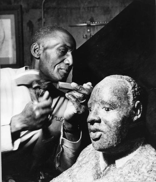 James Washington Jr. working on his bust of MLK.