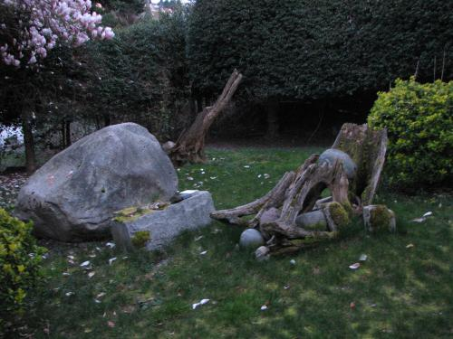 In the backyard are piles of granite Washington intended to carve.