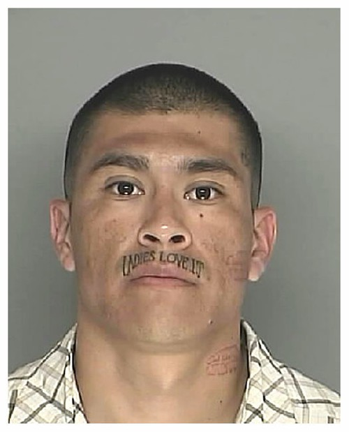 (And yes, those are lipstick tattoos on his neck and cheek.
