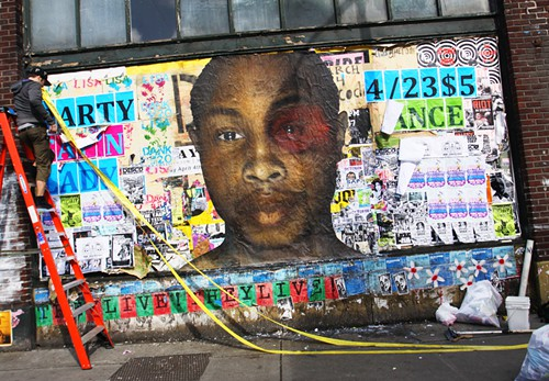 This giant poster went up the morning of the opening on 11th and Pike, on the same block as the East Precinct. Maikoyo Alley-Barnes was as surprised as anyone else to see his face there. It was the work of his friends.
