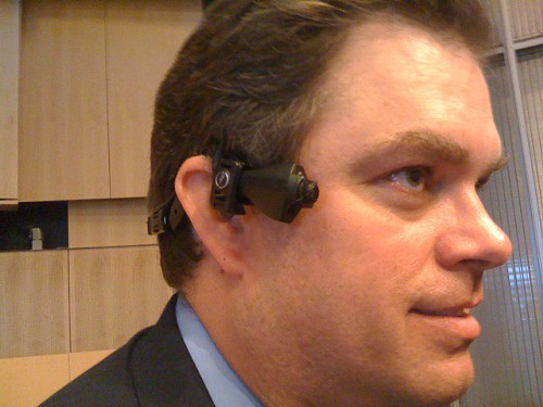 Taser International Chairman Tom Smith displays the AXON head camera