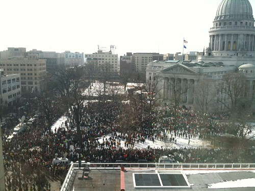 Thousands brave cold to march on state capitol in Madison, Wisconsin today, to protest plans to revoke public employees right to collective bargaining.