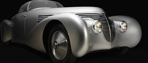 A fancy car! Because automobiles are alluring and alliteration is alluring and art is not as alluring as all that.