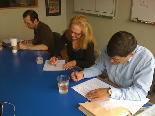 John Cummings, Sharon Peaslee, and Peter Maier take a SECB civics exam on the Constitution, Abraham Lincoln, and capitalism.