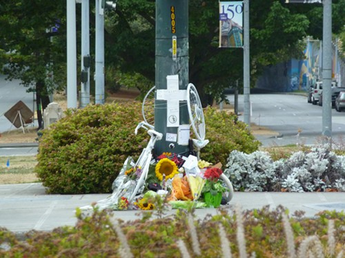 Across the street, the memorial for Robert Townsend, 23.