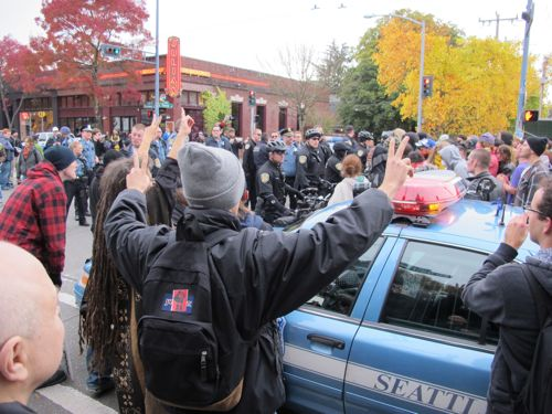 A phalanx of cops clashes with a mob of protesters