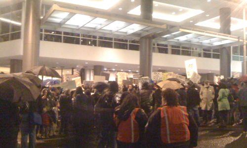 Protesters occupy Sixth Avenue outside the Sheraton Hotel.