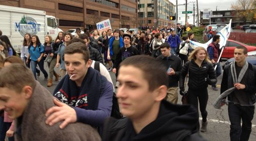Students surge through the intersection of Boren Avenue and James Street
