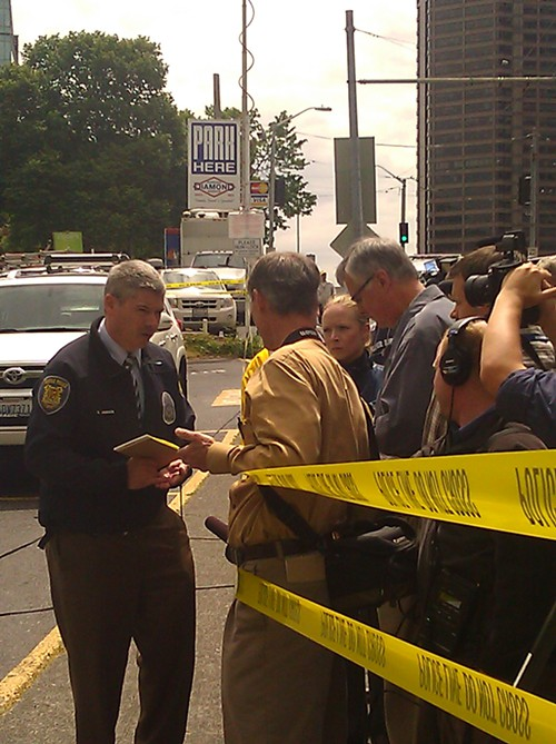 Detective Mark Jamieson, talking to reporters at 8th and Seneca.