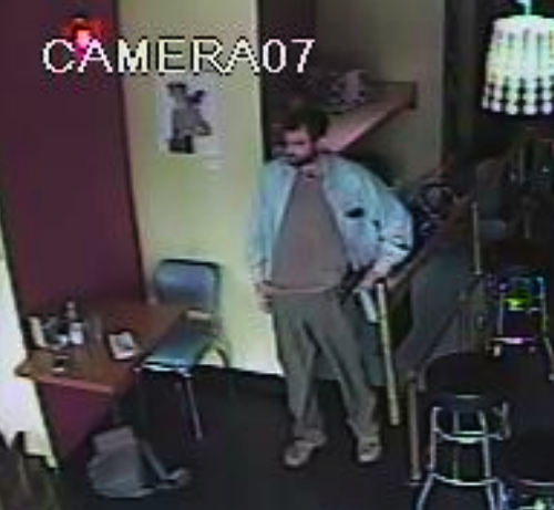 The SPD says: The suspect is a white male, approximately 30 years old, wearing a dark short cap, with well-groomed dark hair, a neat full beard, wearing a light blue jacket. He is considered armed and dangerous. If you recognize this man, please immediately contact the SPD tip line at 206-233-5000 or call 911.