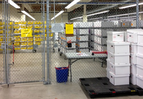 Ballots are stored in a floor-to-ceiling cage.