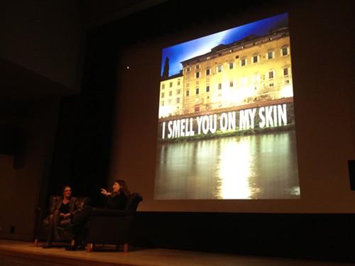 Jenny Holzer in front of a Jenny Holzer, 3.