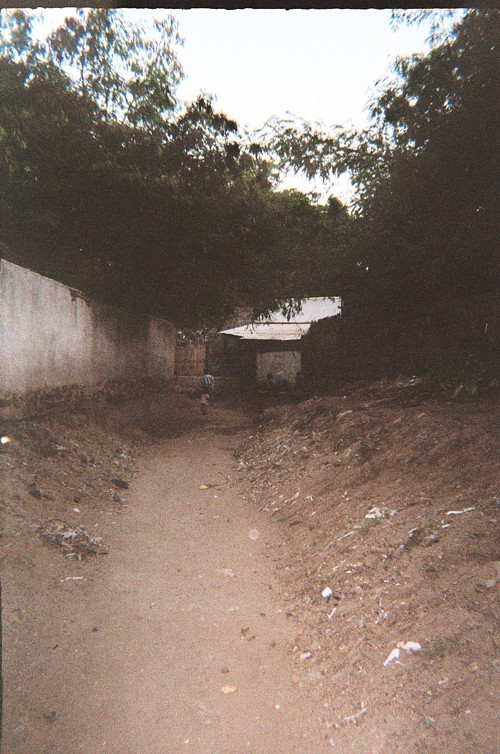 We dont have a real digital camera, only disposable Kodak ones. I gave mine to one kid in a village and told him to take a picture of whatever he wanted. This was the result—the street in front of his house.