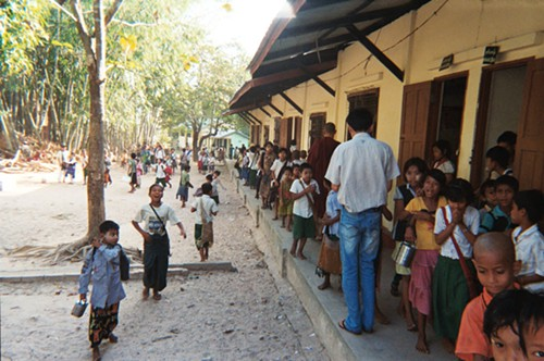 Kids getting out of monastery-school class.