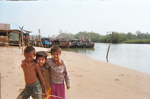 Some rambunctious kids on the beach of a fishing village on the west coast.