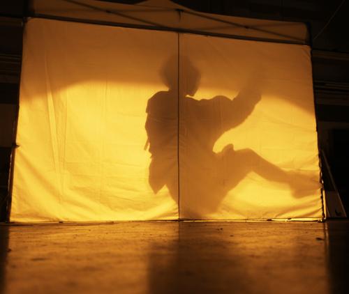 Someone dancing inside DK Pans pot tent.