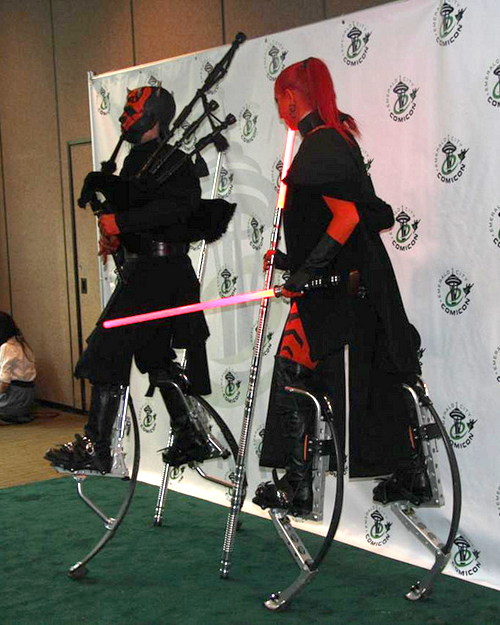 Darth Maul, on stilts, playing the Star Wars theme on bagpipes.
