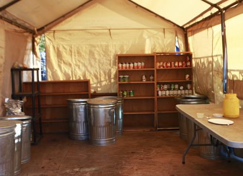 This is Nickelsvilles kitchen and pantry; the shelves are almost bare. Is this less food than usual? Oh, its way down, says Jolly. They used to get so many donations that this was full and they stored overflow in a smaller tent nearby. But since news of the camps shutdown has been public, he says, Everybody thinks after September 1, theres no more Nickelsville.