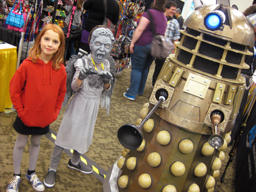Amy Pond and a Weeping Angel encounter a Dalek