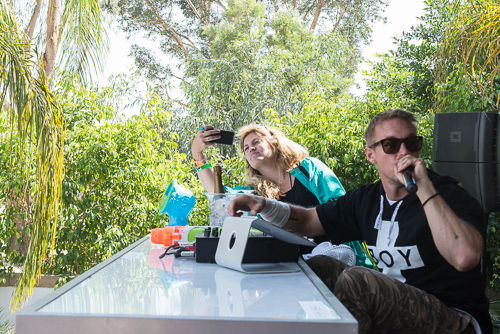 Diplo, tending to a poolside iPad for Sonos