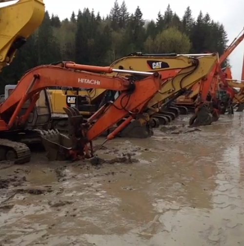 Excavators bowing their heads.