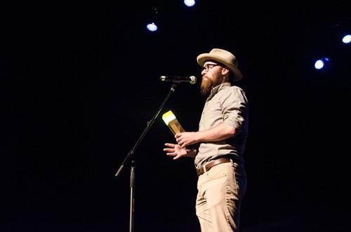 Film Genius winner Drew Christie, looking animated with his new light sabre.