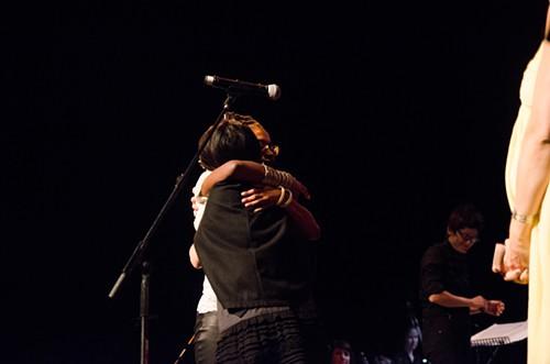 Former Genius winner Susie Lee hugs 2014 visual arts victor C. Davida Ingram.
