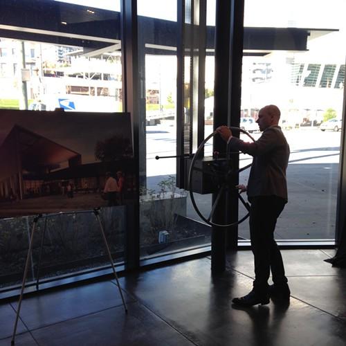 TAM curator Rock Hushka turning the wheel that controls Kundigs solar shades.