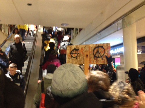 Protesters are going up the escalators at Westlake.
