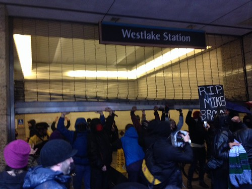 Protesters are trying to get into the bus tunnel. Some people were pepper sprayed as police were trying to close gate.