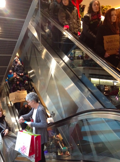 Shopper going up, protesters going down at Pacific Place.