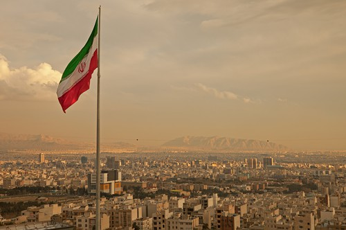 The Iranian flag flies over Tehran.