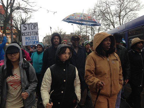 More than 100 people marched on Capitol Hill Saturday in protest of racial profiling and the arrest of a 70-year-old black man for no apparent reason.
