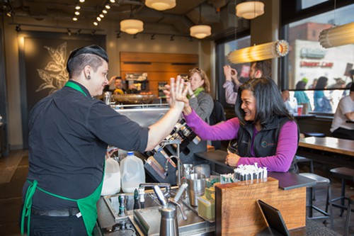 Jayapal was among those who handed out flyers to employees at franchises such as Starbucks and Subway on Capitol Hill and First Hill to let them know about the coming minimum wage increase.