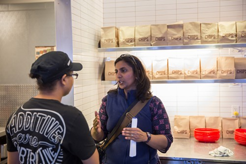 In Chipotle, where employees knew about their upcoming raise, Seattle City Council Member Kshama Sawant told them her next fight will be for housing affordability.