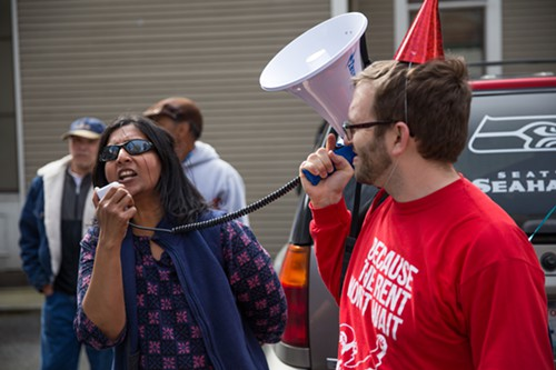 """Congratulations to you all and to us all on this phenomenal historic victory,"" Sawant said at the beginning of her remarks in the parking lot of McDonald's. Later, she continued: ""Let's make sure that all workers know they are getting their rightful legal wage and they know we are on their side and we have their backs if they challenge their bosses against wage theft. Let's make sure that we will fight for them if they are intimidated, threatened, harassed, or fired for asking for their rights."""