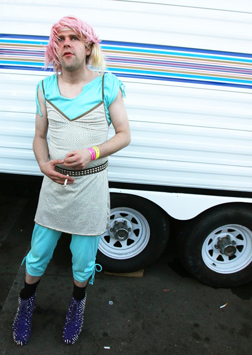 This is musician Ariel Pink. He didnt really seem to like having his picture taken either. I think if youre wearing shoes like this, you should EXPECT IT, though.