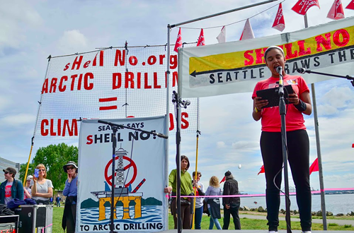 Sarra Tekola, of the University of Washingtons divestment movement: This is the people versus Shell. Complacency equals consent. And if you arent standing up against Shell when theyre here in our backyard, then you are also guilty.