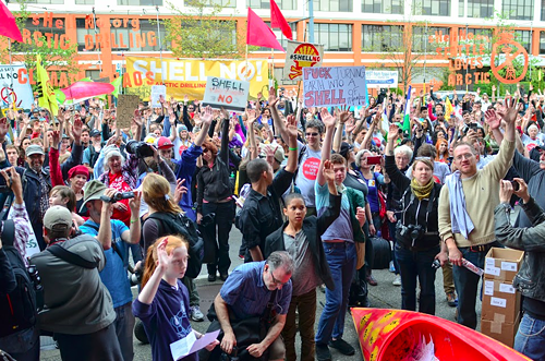 Once at the Port of Seattle building, organizer Kurtis Dengler asked the crowd how many people found out about the ports winter mooring deal for Shell after the lease had already been signed.