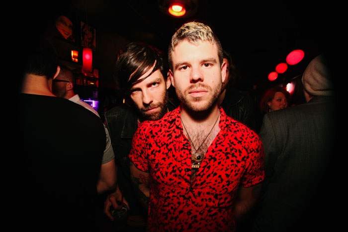 Garrett Vance snuggles up behind Maxwell Brisben at the after party--Vance also had a song featured in the film.