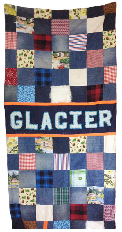 "Joey Veltkamp's Glacier quilt. His version of the domestic ""feminine"" craft is patterned with butch plaids and symbols of the rugged outdoors."