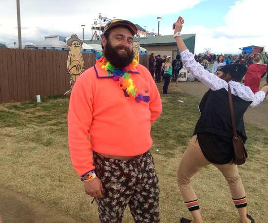 Hot coral Patagonia man is everything a Northwest musical festival could and should be (bonus points for whatever is going on next to him).