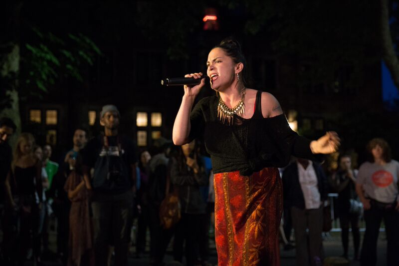 MC Julie C performs in front of the crowd on Greek Row, as part of the message-based entertainment.