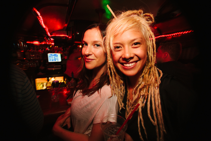 Lauren and Gabriela, two very friendly and familiar faces in the house community, grab a drink from the bar.
