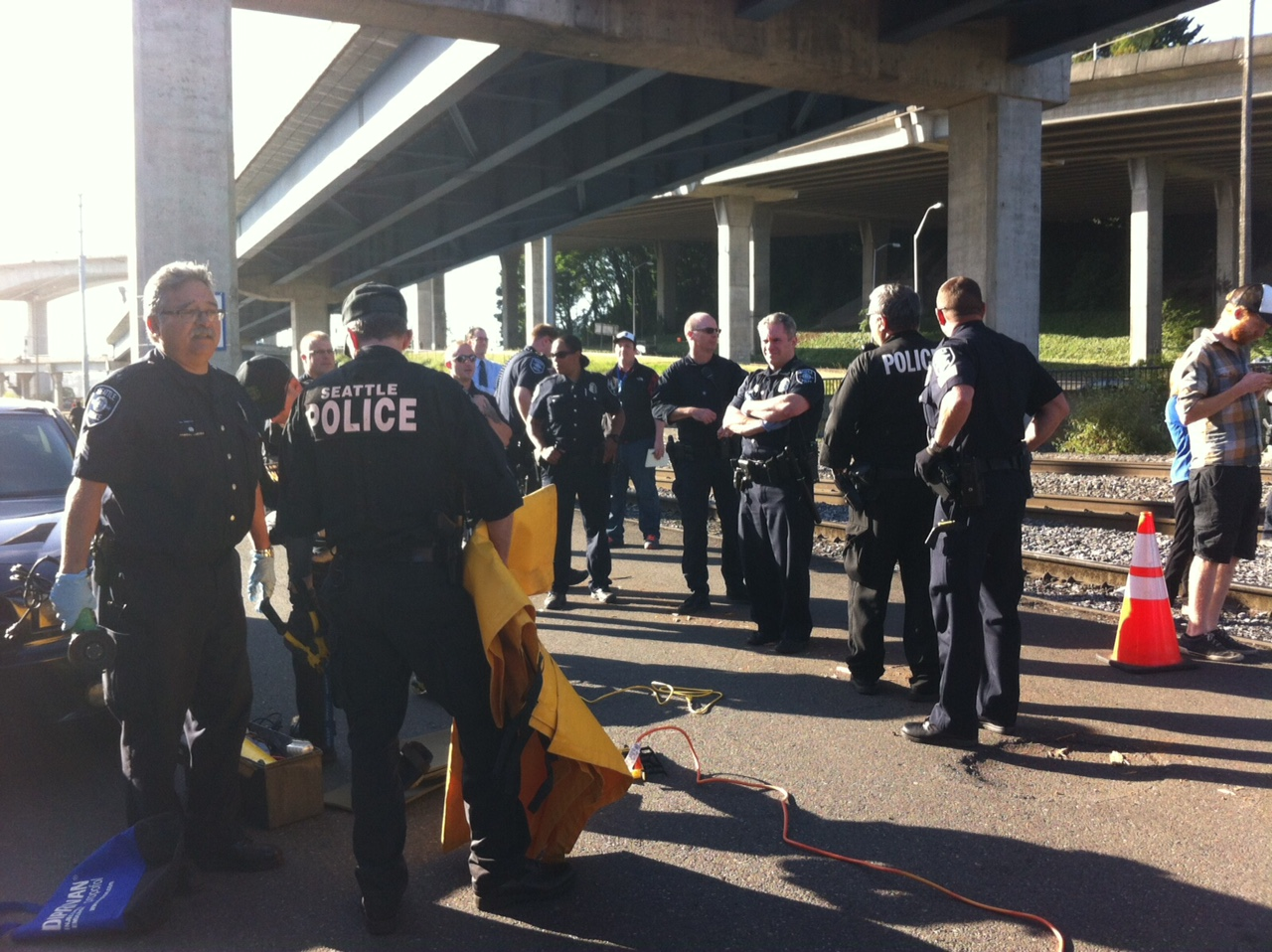 There are fewer cops on site today than at the protests over the weekend. A BNSF spokesperson says trains have been stopped since 6:30 a.m.