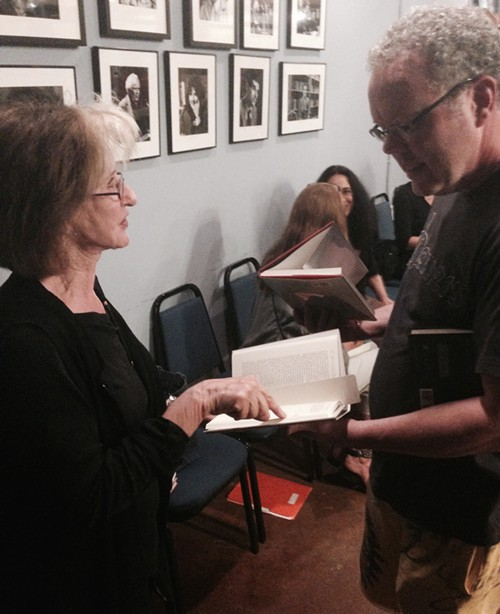 Poet C.D. Wright, signing books. She read from her late partners book. Best line: Your bed is a sad cafe.