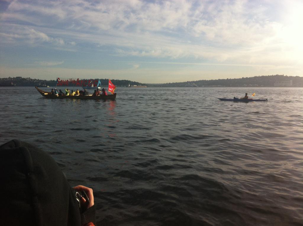 The only protesters left on the water as of 7:30 am are the folks in this Lummi canoe.