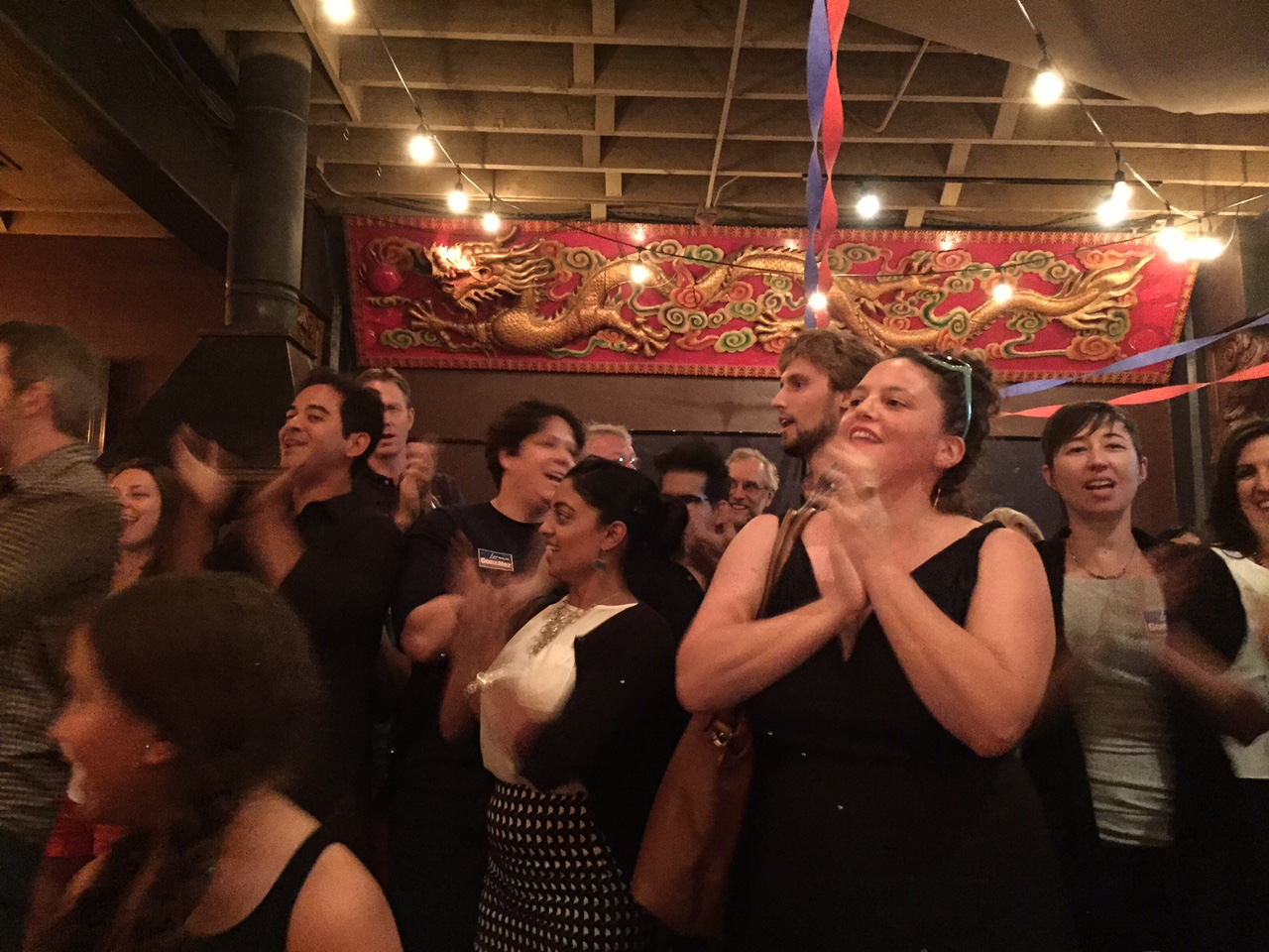 Supporters of Lorena González cheer her victory in citywide Position 9.