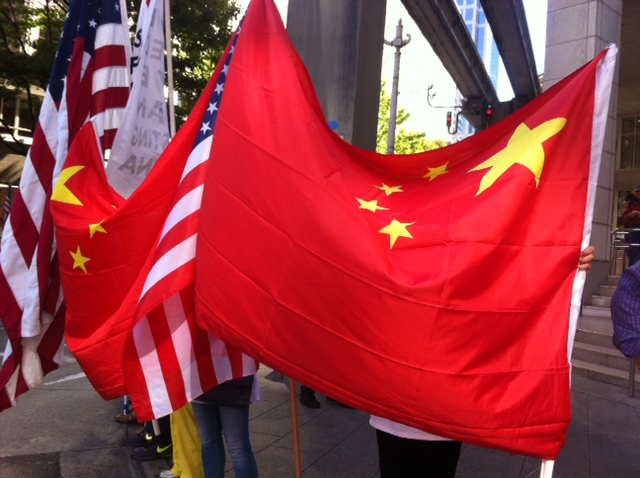 Yang* (last name) didnt want her face photographed, but she allowed a photo of the flag she was holding.